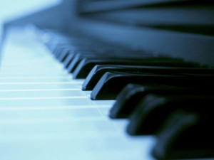 Blue soft light on piano keys